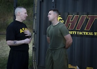 Army Command Sgt. Maj. John W. Troxell, left, senior enlisted advisor to the chairman of the Joint Chiefs of Staff, talks with Marine Corps Sgt. Matthew Bragg after a morning physical training session at Camp H.M. Smith, Hawaii, Feb. 10, 2016. Bragg is a mass communicator assigned to U.S. Marine Corps Forces, Pacific. Marine Corps photo by Sgt. Erik Estrada