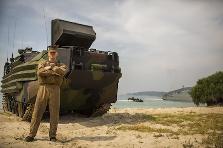 U.S. Marine Corps Lance Cpl. Jacob Irland, assault amphibious vehicle crewmember with 1st Battalion, 5th Marines, poses for photograph after an amphibious capabilities demonstration at Hat Yao, Rayong, Thailand, during exercise Cobra Gold, Feb. 12, 2016. Cobra Gold is a multinational training exercise developed to strengthen security and interoperability between the Kingdom of Thailand, the U.S. and other participating nations.