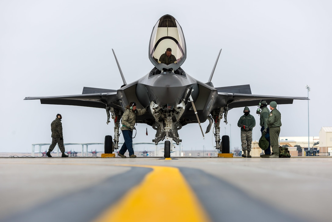 An F-35A Lightning II team parks the aircraft for the first time at Mountain Home Air Force Base, Idaho, Feb. 8, 2016. The aircraft arrived at the base to conduct operational testing in order to determine its combat capabilities. (U.S. Air Force photo/Airman 1st Class Connor J. Marth)