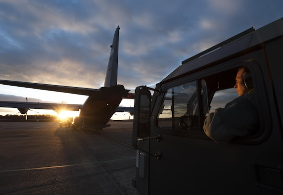 Staff Sgt. Jeffrey Braden, a 19th Logistics Readiness Squadron aircraft services supervisor, loads cargo onto a C-130J Super Hercules with a heavy equipment platform Feb. 8, 2016, at Little Rock Air Force Base, Ark. The cargo was used for loadmaster training. (U.S. Air Force photo/Senior Airman Scott Poe)