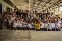 U.S. Marines with Combat Logistics Battalion 3, participate in a community relations event at the Wat Khun Song School, in Chanthaburi, Thailand, exercise Cobra Gold, Feb. 8, 2016. Cobra Gold 2016, in its 35th iteration, includes a specific focus on humanitarian civic action, community engagement, and medical activities conducted during the exercise to support the needs and humanitarian interests of civilian populations around the region.