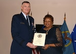 DLA Aviation's Secretary to the Commander Annette Fryar is awarded a certificate of retirement, after 27 years of federal service, from DLA Director, Air Force Lt. Gen. Andy Busch in a ceremony held Feb. 5, 2016 at DLA Aviation's Community Center in Richmond.