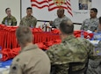 Lt. Gen. Charles Brown Jr., commander of Air Forces Central Command, speaks to a group of Airmen, Soldiers and coalition members during a luncheon at an undisclosed location in Southwest Asia, Feb. 11, 2016. Brown is responsible for developing contingency plans and conducting air operations in a 20-nation area of responsibility covering Central and Southwest Asia. (U.S. Air Force photo by Staff Sgt. Kentavist Brackin/released)