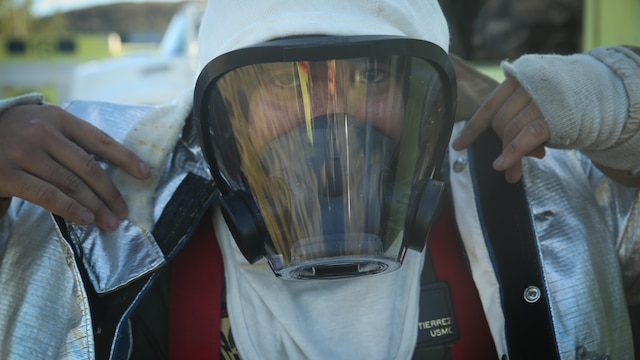 Pfc. Randy Gutierrez, an Air Rescue Fire Fighting turret operator with Kaneohe Bay Marine Corps Air Station, suits up in a fire proximity suit aboard MCAS, Feb. 9, 2016. The mission of ARFF is to protect property and save lives which means the Marines need to be suited up and moving out within seconds of a call. ARFF rescue men work together to prevent aircraft fires, house fires, and any other emergency on the airfield and on base.