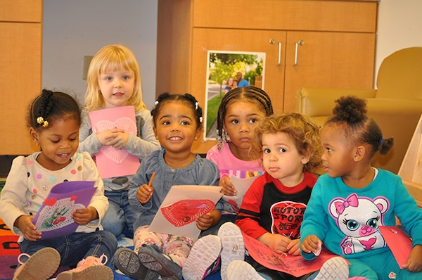 "Children from the Betty Ackerman-Cobb Child Development Center on Defense Supply Center Richmond, Virginia, display valentines they made for veterans Feb. 09, 2016 in support of national ""Salute to Veteran Patients"" week."