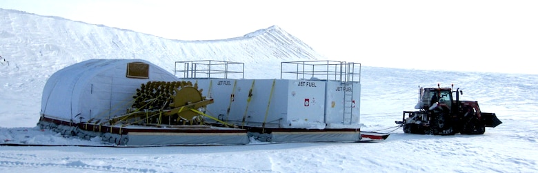 The 2012 Greenland traverse delivered two large fuel-storage tanks and a heavy roller-compactor to Summit Station by using lightweight cargo sleds developed by CRREL.