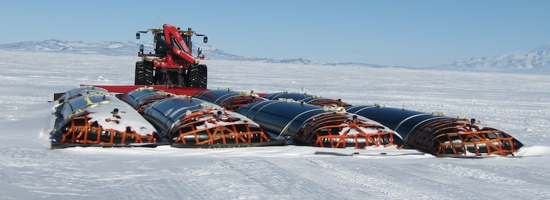 During South Pole Traverse 2010–11, a single tractor could tow eight CRREL-developed black fuel bladders.