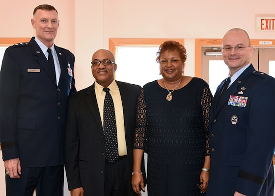 DLA Aviation's Secretary to the Commander Annette Fryar, center right, retired after 27 years of federal service, in Richmond, Virginia on Feb. 5, 2016 in a ceremony held at the Community Center on Defense Supply Center Richmond. Fryar is accompanied by her husband Charles Fryar, center left, DLA Director  Air Force Lt. Gen. Andy Busch, left, who retired Fryar at the ceremony, and DLA Aviation Commander Allan Day, right.