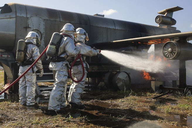 Marines practice fire suppression methods during aircraft rescue firefighting training on Marine Corps Base Hawaii, Feb. 10, 2016. Lance Cpl. Jesus Sepulveda Torre