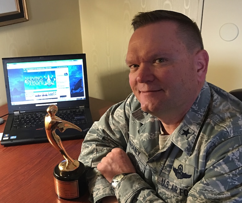 "Brig. Gen. Samuel ""Bo"" Mahaney, Air Reserve Personnel Center commander, sits admiring his Air Force Reserve Command Public Affairs Champion award Feb. 9, 2016. (Courtesy photo: Mrs. Chris Mahaney)"