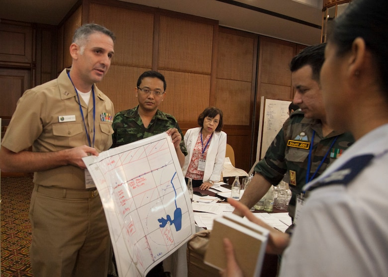 Exercise Cobra Gold 16 Medical Symposium participants look at the layout of the medical camp they created during a humanitarian assistance disaster response table top exercise Feb. 11 at the K.P. Grand Hotel, Chanthaburi, Thailand. The symposium, Feb. 9-12, focused on the exchange of knowledge and techniques about HADR. As part of the overall focus of CG16, the symposium and other programs will improve the quality of life, as well as the general health and welfare of civilian residents in the exercise areas.