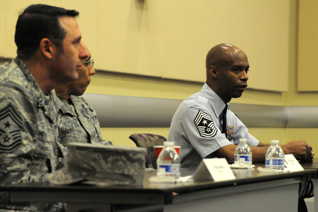 Chief Master Sgt. Vance Kondon, 11th Wing command chief, CMSgt Manuel Pineiro, Air Force District of Washington first sergeant and CMSgt Nathaniel Perry, 79th Medical Wing command chief, speak to participants during Air Force District of Washington's sixth annual Capital Airmen Development Seminar on Joint Base Andrews, Md., Feb. 10, 2015. The professional development opportunity, which included briefings by senior Air Force leaders, candid discussions, and a tour of the U.S. Capitol building, was designed to increase participants' understanding of current Air Force issues and programs. 