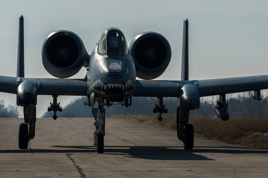 A 74th Expeditionary Fighter Squadron A-10C Thunderbolt II aircraft pilot taxis down a runway before refueling at Plovdiv, Bulgaria, Feb. 9, 2016. The aircraft conducted austere landing training along with forward area refueling point training to bolster air power capabilities while assuring the U.S. commitment to European security and stability. (U.S. Air Force photo by Airman 1st Class Luke Kitterman/Released)