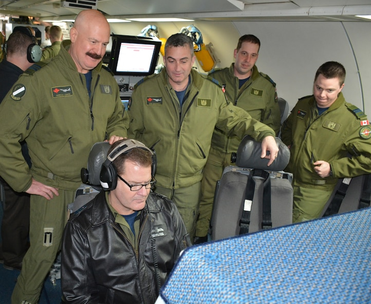"Lt. Gen. Mike Hood, commander of the Royal Canadian Air Force, seated, listens to a recording of a recent mission performed by members of the 552nd Air Control Wing during a tour of an E-3 ""Sentry"" Airborne Warning and Control System Block 40/45 aircraft on Feb. 3 at Tinker Air Force Base. Looking over the general's shoulder and taking part in the E-3 static display are, from left, Maj. Gordon Lemon, mission crew commander; Lt. Col. Donald Saunders, 552nd ACW Canadian Detachment commander; Capt. Andrew Baier, airborne surveillance officer; and Capt. Anthony Snow, senior director. General Hood, assigned to the National Defense Headquarters in Ottawa, visited with the Canadian Detachment that consists of 39 members of the Royal Canadian Air Force and three members of the Canadian Army. During his visit, the general also met with Col. David Gaedecke, 552nd ACW commander, and held a commander's call with members of the detachment. The partnership between the Canadian Detachment, which falls under the 552nd ACW, is now in its 36th year. The Detachment first began working with the 552nd ACW in 1979. (Air Force photo by Darren D. Heusel/Released)"