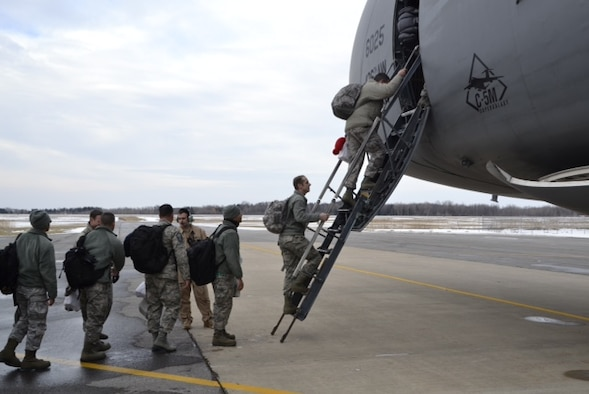 Members from the 174th Attack Wing load onto an aircraft in January as they prepare to deploy from Hancock Field Air National Guard Base. (Courtesy photo/Released)