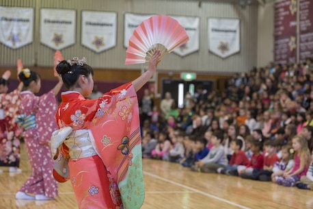 Children from the Shunan International Children's Club perform a traditional Japanese dance during a cultural exchange at Matthew C. Perry Elementary School at Marine Corps Air Station Iwakuni, Japan, Feb. 11, 2016. The children's club performs annually at the elementary school and in turn invites the school to the Hinamatsuri festival every year.  These Japanese cultural exchange events showcase the nation's unique culture in hopes of deepening friendships and understanding. (U.S. Marine Corps photo by Cpl. Nicole Zurbrugg/Released)