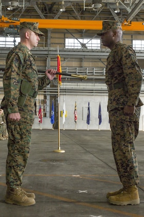 Sgt. Maj. Darnell Richardson, right, outbound Marine Aviation Logistics Squadron 12 sergeant major, returns the sword of office to Lt. Col. Kolter Miller, MALS-12 commanding officer, during a relief and appointment ceremony at Marine Corps Air Station Iwakuni, Japan, Feb. 12, 2016. This ceremony symbolizes the end of Richardson's role as MALS-12 sergeant major. The passing of the sword of office represents the transferring of duties and responsibilities from one sergeant major to another.