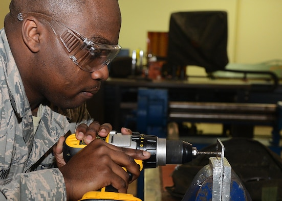 Senior Airman Chandler Brown, 36th Maintenance Squadron aircraft structural maintenance journeyman, drills a hole into a piece of sheet metal Feb. 2, 2016, at Andersen Air Force Base, Guam. The aircraft structural maintenance section is responsible for the structural maintenance and corrosion control on transient and deployed aircraft, which includes inspecting, repairing, painting and removal of corrosion on support equipment. (U.S. Air Force photo/Airman 1st Class Arielle Vasquez)