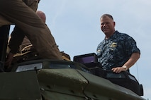 Rear Adm. John B. Nowell smiles at the camera as he exits an AAV-P7/A1 Amphibious Assault Vehicle Feb. 11, 2016, in Hat Yao, Rayong, Thailand. The AAV had just left the USS Ashland (LSD 48) to practice a ship-to-shore mission for Cobra Gold 16. CG16 is a Thai-U.S. co-sponsored exercise that allows partnering nations to improve cohesion between partner militaries and sustain regional security.