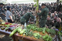 U.S. Marines assigned to the 31st Marine Expeditionary Unit, along with Thai and Korean Marines, watch Royal Thai Marine Petty Officer 1st Class Chaiwat Ladsim, assigned to Recon Battalion, demonstrate how to retrieve water from a banana tree as part of jungle survival training during Cobra Gold 2016 on Camp Ban Chan Krem, Thailand, Feb. 13, 2016. CG16 provides a joint, combined task force venue for all participating nations to advance interoperability and increase capacity to conduct combined task force events.
