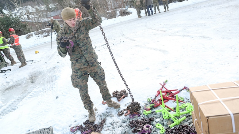 A Marine with 2nd Marine Expeditionary Brigade prepares the tie down chains shortly before transporting multiple vehicles by rail at Hell Station in Hell, Norway Feb. 12, 2016. The rail operations were in preparation for Exercise Cold Response 16, comprised of 13 allied and partner nations, and over 16,000 troops, starting later this month.