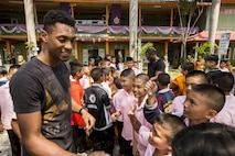 U.S. Marines interact with children at the Wat Samnak Ka Thon School, Rayong District, Thailand, during exercise Cobra Gold, Feb. 9, 2016. Cobra Gold, in its 35th iteration, includes a specific focus on humanitarian civic action, community engagement, and medical activities conducted during the exercise to support the needs and humanitarian interests of civilian populations around the region.
