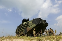 A U.S. Marine Corps Assault Amphibious Vehicle comes ashore in an amphibious capabilities demonstration at Hat Yao, Rayong, Thailand, during exercise Cobra Gold, Feb. 12, 2016.  Cobra Gold is a multinational training exercise developed to strengthen security and interoperability between the Kingdom of Thailand, the U.S. and other participating nations.