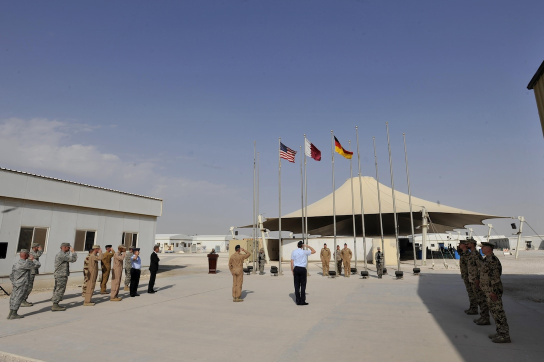 German Air Force members and coalition partners salute during a German flag raising ceremony at Al Udeid Air Base, Qatar, Feb. 8, 2016. The ceremony recognized the addition of Germany to the coalition supporting Operation Inherent Resolve. (U.S. Air Force photo by Master Sgt. Joshua Strang/Released)