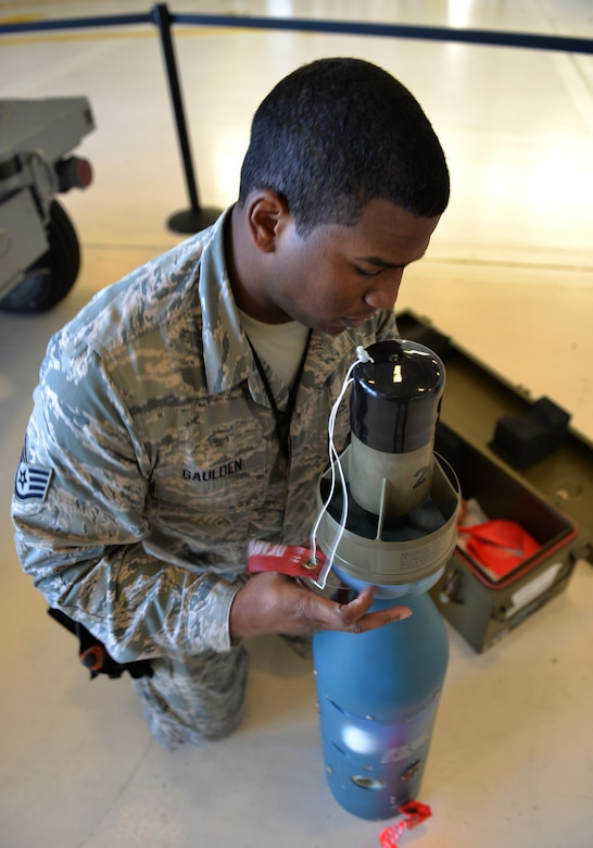 Staff Sgt. Timothy Gaulden, a 33rd Aircraft Maintenance Squadron weapons load crew chief, inspects a joint direct attack munition for the first F-35A Lightning II load competition at Eglin Air Force Base, Fla., Feb. 5, 2016. This was the first competition hosted at the 33rd Fighter Wing in seven years. (U.S. Air Force photo/Senior Airman Andrea Posey)