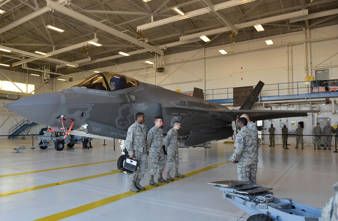 Load crew members from the 33rd Aircraft Maintenance Squadron prepare to participate in the first annual F-35A Lightning II load competition at Eglin Air Force Base, Fla., Feb. 5, 2016. The 33rd Fighter Wing hosted four quarterly load competitions where Airmen competed to qualify for the event. (U.S. Air Force photo/Senior Airman Andrea Posey)