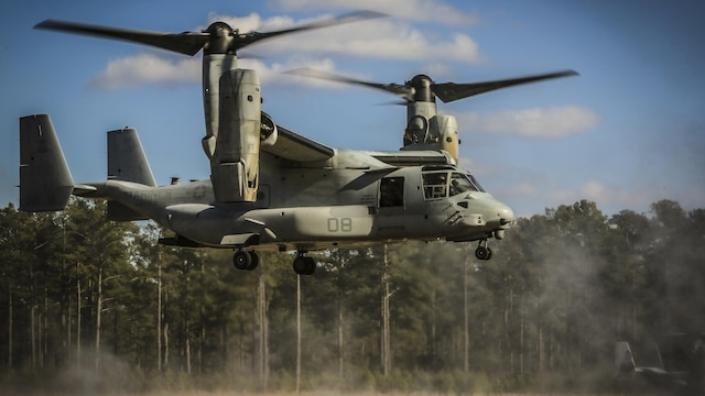 Maj. Steven R. Huls and Capt. Edward K. Williams navigate a MV-22B Osprey into a landing zone during section confined area landings near Marine Corps Air Station New River, N.C., Feb. 10, 2016. Marines with VMM-365 flew to a landing zone, which allowed pilots to practice CALs in their Osprey's and then flew several miles off the coast to practice their proficiency with shooting the M2 Browning .50-caliber machine gun. Huls and Williams are pilots with Marine Medium Tiltrotor Squadron 365.