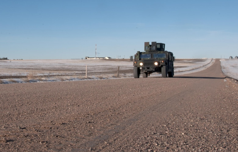 A 90th Missile Security Force Squadron Humvee patrols the F.E. Warren Air Force Base, Wyo., missile complex Feb. 9, 2016. A Simulated Electronic Launch-Minuteman test was conducted that day. (U.S. Air Force photo by Senior Airman Jason Wiese)