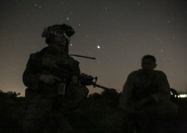 A Marine secures the simulated downed pilot and awaits extraction during the night portion of a tactical recovery of aircraft and personnel, or TRAP, training scenario at Camp Pendleton, Calif., Feb. 8, 2016. TRAP is used to tactically recover personnel, equipment or aircraft by inserting a recovery force to the objective location. The Marine is with 2nd Battalion, 4th Marine Regiment, 1st Marine Division. (U.S. Marine Corps photo by Lance Cpl. Devan K. Gowans/Released)