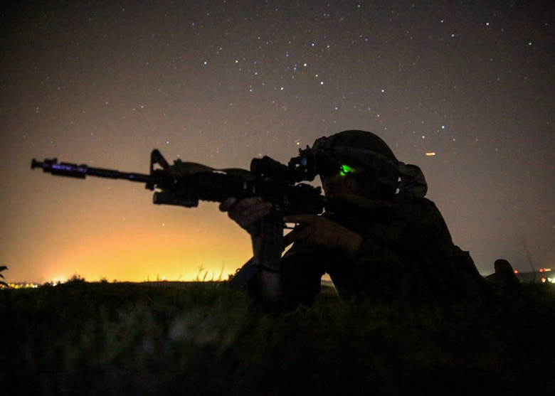 A Marine provides security for his team during the night portion of a tactical recovery of aircraft and personnel, or TRAP, training scenario at Camp Pendleton, Calif., Feb. 8, 2016. TRAP is used to tactically recover personnel, equipment or aircraft by inserting the recovery force to the objective location. The Marine is with Weapons Company, 2nd Battalion, 4th Marine Regiment, 1st Marine Division. (U.S. Marine Corps photo by Lance Cpl. Devan K. Gowans/Released)