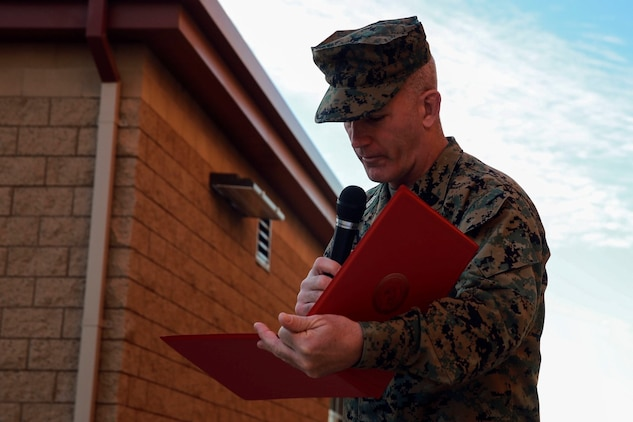 Sgt. Maj. Bradley Kasal reads the award citation naming Cpl. Corey Mount as the I Marine Expeditionary Force Marine of the Year during a ceremony at Camp Pendleton Feb. 10, 2016. The award recognizes a Marine who exceeds expectations and embodies the spirit and ideals of the Marine Corps. Kasal, a native of Marengo, Iowa, is the I MEF sergeant major and Mount, a native of Indianapolis, is an administrative noncommissioned officer with 1st Reconnaissance Battalion, 1st Marine Division, I MEF. (U.S. Marine Corps photo by Lance Cpl. Caitlin Bevel)