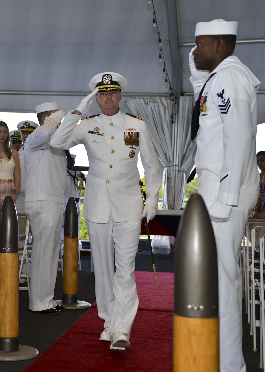 160212-N-LY160-031  JOINT BASE PEARL HARBOR-HICKAM, Hawaii (Feb. 12, 2016) Cmdr. John L. Croghan salutes sideboys during the change of command ceremony for the Los Angeles-class fast attack submarine USS Jefferson City (SSN 759) at the Battleship Missouri Memorial. (U.S. Navy photo by Mass Communication Specialist 2nd Class Michael H. Lee