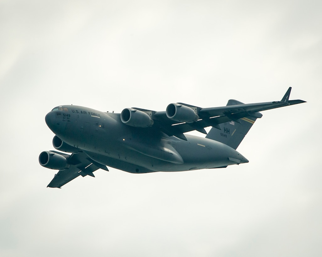 A U.S. Air Force C-17 Globemaster III from the 15th Wing at Joint Base Pearl Harbor-Hickam, Hawaii, practices its aerial demonstration routine prior to the Singapore International Airshow, at Changi International Airport Singapore, Feb. 15, 2016. Through participation in airshows and regional events, the U.S. demonstrates its commitment to the security of the Indo-Asia-Pacific region, promotes equipment interoperability, displays the flexible combat capabilities of the U.S. military, and creates lasting relationships with international audiences to strengthen the bonds that support partnership building throughout the Indo-Asia-Pacific region. (U.S. Air Force photo by Capt. Raymond Geoffroy/Released)