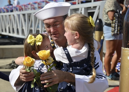 160212-N-LY160-245 PEARL HARBOR (Feb. 12, 2016) Machinist's Mate 2nd Class Noah Huston of Port Orchard, Wash., is reunited with his 5-year-old daughter, Alice, 2-year-old  daughter, Lucy and wife, Ana, following the return of the Los Angeles-class fast attack submarine USS City of Corpus Christi (SSN 705) to Pearl Harbor, after completing a successful 5-month Indo-Asia-Pacific deployment. (U.S. Navy photo by Mass Communication Specialist 2nd Class Michael H. Lee/Released)