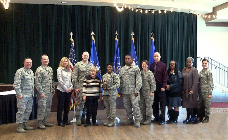 "Brig. Gen. Samuel ""Bo"" Mahaney, Air Reserve Personnel Center commander, and Chief Master Sgt. Ruthe Flores, ARPC command chief, present the ARPC Team of the Year award to members from the Individual Readiness Reserve Muster Team. Mahaney honored ARPC's 2015 outstanding performers of the year Feb. 16, 2016, at the Heritage Eagle Bend Country Club in Aurora, Colo.(U.S. Air Force photo/Quinn Jacobson)"
