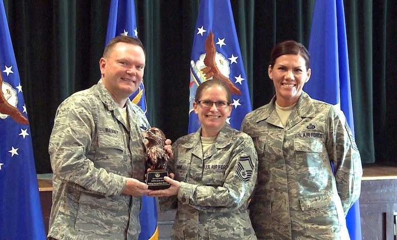"Brig. Gen. Samuel ""Bo"" Mahaney, Air Reserve Personnel Center commander, and Chief Master Sgt. Ruthe Flores, ARPC command chief, present the ARPC Senior Noncommissioned Officer of the Year award to Senior Master Sgt. Jacqueline Rinne. Mahaney honored ARPC's 2015 outstanding performers of the year Feb. 16, 2016, at the Heritage Eagle Bend Country Club in Aurora, Colo. (U.S. Air Force photo/Quinn Jacobson)"