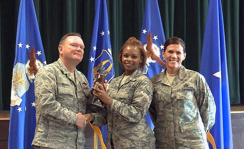 "Brig. Gen. Samuel ""Bo"" Mahaney, Air Reserve Personnel Center commander, and Chief Master Sgt. Ruthe Flores, ARPC command chief, present the ARPC Airman of the Year award to Senior Airman Rachel Smith. Mahaney honored ARPC's 2015 outstanding performers of the year Feb. 16, 2016, at the Heritage Eagle Bend Country Club in Aurora, Colo. (U.S. Air Force photo/Quinn Jacobson)"