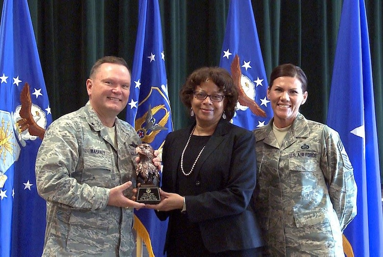"Brig. Gen. Samuel ""Bo"" Mahaney, Air Reserve Personnel Center commander, and Chief Master Sgt. Ruthe Flores, ARPC command chief, present the Category II, Supervisory Civilian of the Year award to Jacqueline Bing. Mahaney honored ARPC's 2015 outstanding performers of the year Feb. 16, 2016, at the Heritage Eagle Bend Country Club in Aurora. Colo. (U.S. Air Force photo/Quinn Jacobson)"