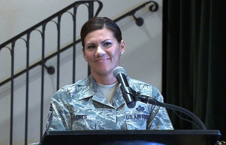 Chief Master Sgt. Ruthe Flores, Air Reserve Personnel Center command chief, speaks to attendees during a breakfast honoring ARPC's annual award winners Feb. 16, 2016, at the Heritage Eagle Bend Country Club in Aurora, Colo. (U.S. Air Force photo/Quinn Jacobson)
