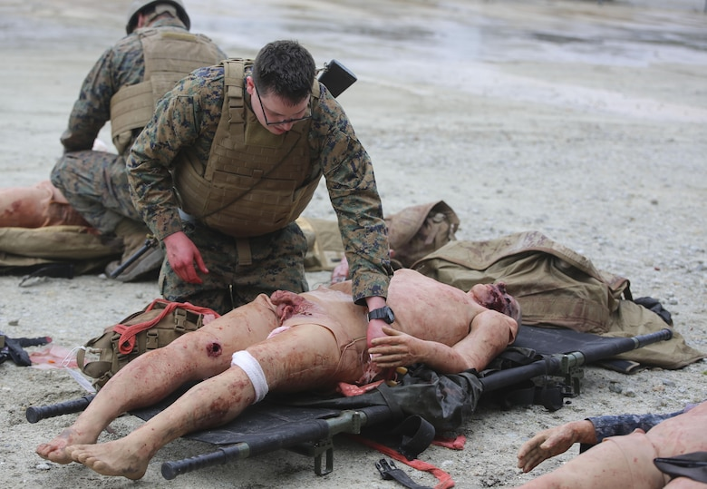U.S. Navy Petty Officer Second Class Aaron Matthess, a hospital corpsman with 2nd Medical Battalion, treats a casualty during a tactical combat casualty care exercise at Camp Lejeune, N.C., Feb. 12, 2016. The extent of the injuries sailors had to treat on their patients included penetrating chest trauma, shrapnel penetration, amputation, airway obstructions and facial trauma. (U.S. Marine Corps photo illustration by Cpl. Paul S. Martinez/Released)