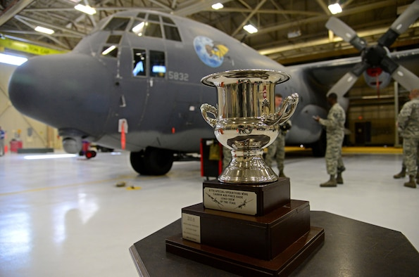 The 27th Special Operations Wing load crew of the year trophy sits atop a display table in the competition arena Feb. 5, 2016, at Cannon Air Force Base, N.M. Cannon's elite weapons troops came together for the second consecutive year to display load capabilities and precision. (U.S. Air Force photo/Staff Sgt. Alexx Pons)