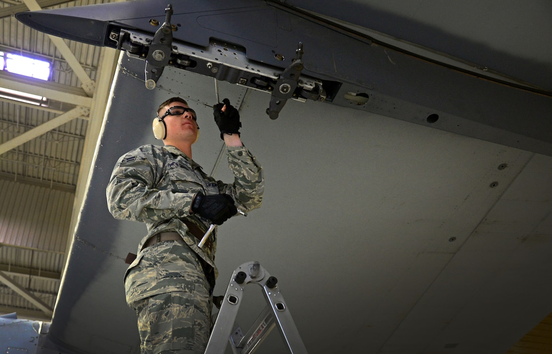 Airman 1st Class Dylan Yarish, 27th Special Operations Maintenance Squadron AC-130W armament unit, makes load preparations to a MAU-40 bomb rack Feb. 5, 2016, at Cannon Air Force Base, N.M. Weapons troops provided a real-time look into career field precision during the second consecutive competition. (U.S. Air Force photo/Staff Sgt. Alexx Pons)