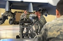 Airmen from the 27th Special Operations Maintenance Squadron MQ-9/CV-22 armament unit load an inert GBU-38 on an MQ-9 Reaper during Cannon's annual load competition Feb. 5, 2016, at Cannon Air Force Base, N.M. Both teams moved quickly in an attempt to claim victory during the second consecutive competition. (U.S. Air Force photo/Staff Sgt. Alexx Pons)