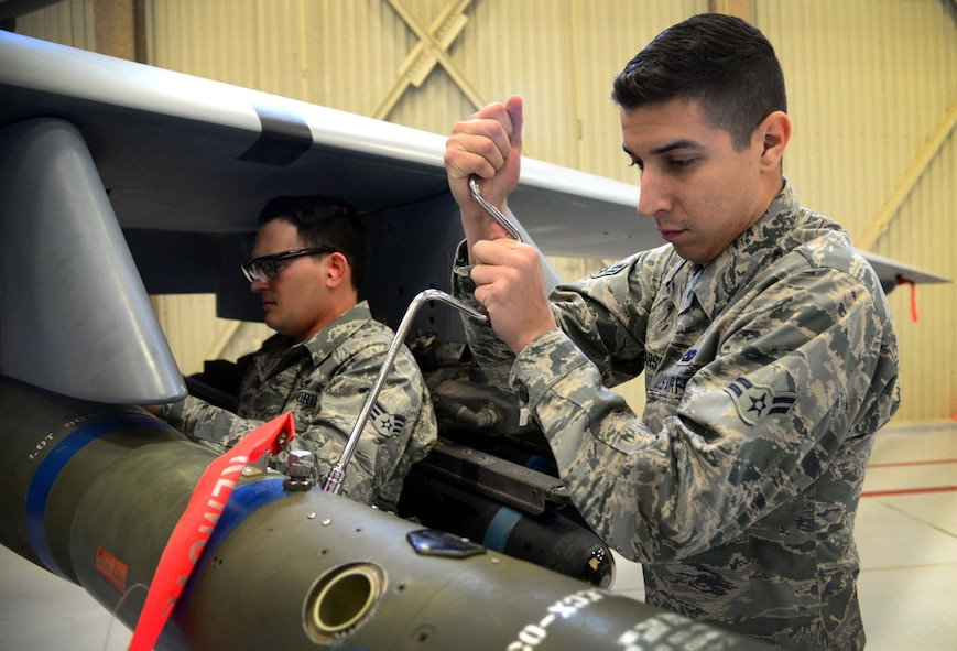 Airman 1st Class Jonathan Marsico, 27th Special Operations Maintenance Squadron MQ-9/CV-22 armament unit, works to secure an inert GBU-12 during an annual load competition Feb. 5, 2016, at Cannon Air Force Base, N.M. Both teams worked diligently to showcase skills during the second consecutive competition. (U.S. Air Force photo/Staff Sgt. Alexx Pons)