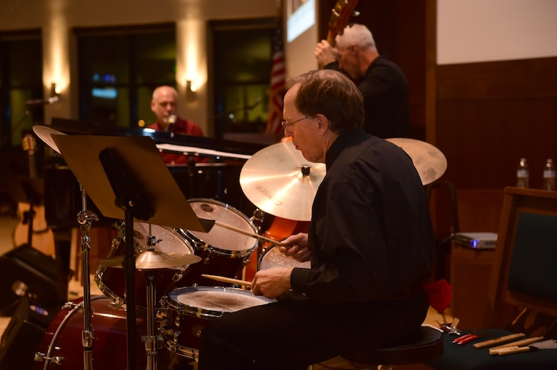 """Danny Byram and his band play for members of the Buckley community Feb. 12, 2016, at the Buckley Chapel on Buckley Air Force Base, Colo.  Nicknamed """"The Combat Musician,"""" Byram has performed at more than 100 U.S. military installations worldwide, more than any other Christian musician. (U.S. Air Force photo by Airman 1st Class Luke W. Nowakowski/Released)"""
