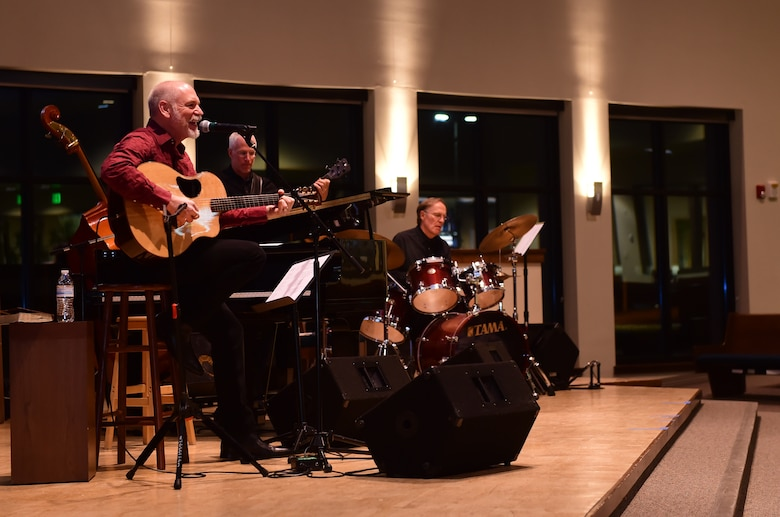 """Danny Byram, a musician, plays at the Buckley Chapel with his band Feb. 12, 2016, on Buckley Air Force Base, Colo. Nicknamed """"The Combat Musician,"""" Byram has performed at more than 100 U.S. military installations worldwide, more than any other Christian musician. (U.S. Air Force photo by Airman 1st Class Luke W. Nowakowski/Released)"""